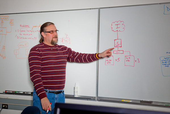 """Computer Science Associate Professor Jon Genetti points to a diagram during a class in the Chapman Building ASSERT lab.  <div class=""""ss-paypal-button"""">Filename: AAR-12-3272-42.jpg</div><div class=""""ss-paypal-button-end"""" style=""""""""></div>"""