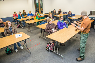 Assistant professor Eduardo Wilner leads a mock philosphy class  with high school seniors during an Inside Out event in a Gruening Building classroom.  Filename: AAR-12-3609-10.jpg