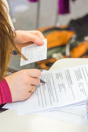 Students in Associate Professor Dani Sheppard's Psychology 335 class, Brain and Behavior, take their final exam Dec. 17 in the Gruening Building.  Filename: AAR-14-4414-125.jpg