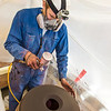 """Art major Ian Wilkinson applies glaze from an airbrush under a temporary visqueen tent set up in the ceramics studio. The large pot is part of his BFA thesis project which opens next week in the UAF Fine Arts gallery.  <div class=""""ss-paypal-button"""">Filename: AAR-13-3768-24.jpg</div><div class=""""ss-paypal-button-end"""" style=""""""""></div>"""