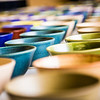 """A few of the 1,200 ceramic bowls made by art major Ian Wilkinson as part of his 2013 senior thesis.  <div class=""""ss-paypal-button"""">Filename: AAR-13-3770-10.jpg</div><div class=""""ss-paypal-button-end"""" style=""""""""></div>"""