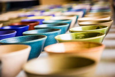 A few of the 1,200 ceramic bowls made by art major Ian Wilkinson as part of his 2013 senior thesis.  Filename: AAR-13-3770-10.jpg