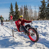 "Mechanical engineering majors Daniel Sandstrom, left, Eric Bookless and Neil Gotschall, front, demonstrate their fat tire ski bike they designed and built for paraplegic users as their spring 2016 senior design project. The bike is powered by pushing and pulling on the handles.  <div class=""ss-paypal-button"">Filename: AAR-16-4856-06.jpg</div><div class=""ss-paypal-button-end""></div>"