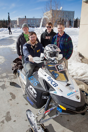 Members of the UAF Clean Snowmachine Team pose outside the Duckering Building with their winning sled upon its return from Haughton, Michigan this afternoon after winning the 2012 SAE Clean Snowmobile Challenge. From left ro right are Karlin Swearingen, Isaac Thompson, Ben Neubauer, and Michael Golub.  **Do not use this images without confirmation from Kim, Jan or Michelle**  Filename: AAR-12-3337-67.jpg