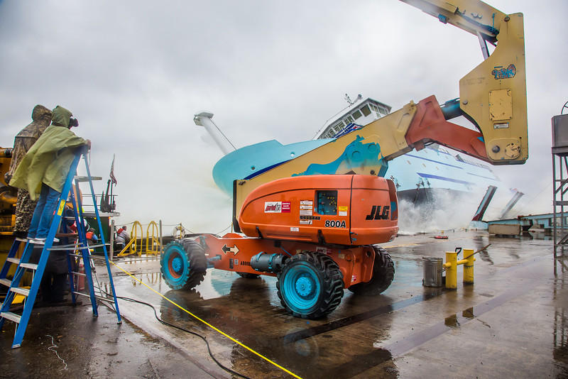 """The R/V Sikuliaq splashes into the water during its launch at the Marinette Marine Corp. in Marinette, Wisc.  <div class=""""ss-paypal-button"""">Filename: AAR-12-3594-140.jpg</div><div class=""""ss-paypal-button-end"""" style=""""""""></div>"""