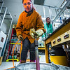 """Research Assistant Professor Jessica Larsen, at right, operates the valve while volcanology graduate student Rebecca deGraffenreid uses water to cool down a rod which contains volcanic remnants after it was pulled from a furnace in the Reichardt Building petrology lab.  <div class=""""ss-paypal-button"""">Filename: AAR-16-4828-101.jpg</div><div class=""""ss-paypal-button-end""""></div>"""