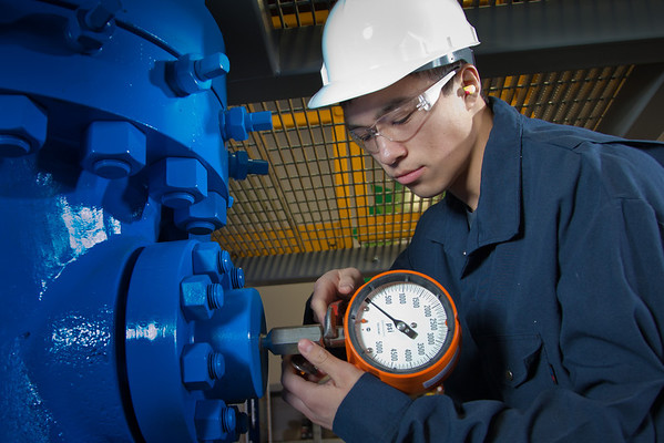"""Stefan Weingarth tightens a pressure gauge on the oil field well head at CTC's process technology facility on Van Horn Road.  <div class=""""ss-paypal-button"""">Filename: AAR-11-3230-001.jpg</div><div class=""""ss-paypal-button-end"""" style=""""""""></div>"""