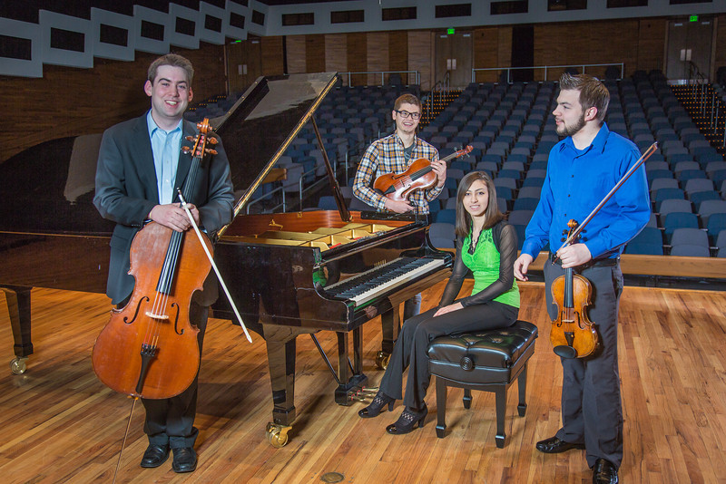 """From left to right, Franz Felkl, Trevor Adams, Ani Gyulamiryan and Bryant Hopkins performed as a quartet during the 2013 UAF Scholarship Breakfast.  <div class=""""ss-paypal-button"""">Filename: AAR-13-3764-02.jpg</div><div class=""""ss-paypal-button-end"""" style=""""""""></div>"""