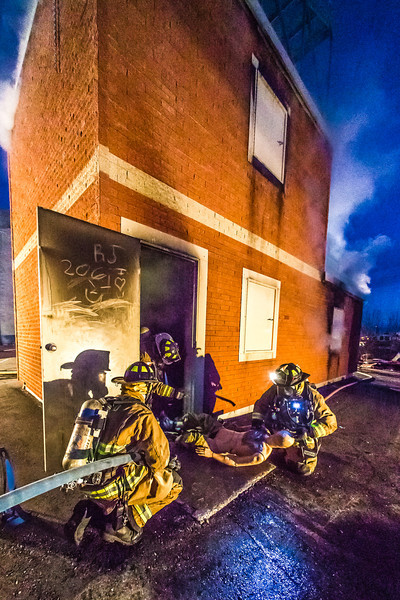 """Student fire fighters with the UFD practice evacuation techniques from a burning building during a live training drill at the Fairbanks Fire Training Center.  <div class=""""ss-paypal-button"""">Filename: AAR-13-3978-124.jpg</div><div class=""""ss-paypal-button-end"""" style=""""""""></div>"""