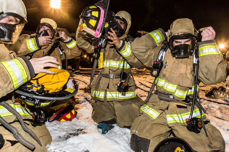 """UFD student firefighters don their gear before tackling a live blaze during a drill at the Fairbanks International Airport.  <div class=""""ss-paypal-button"""">Filename: AAR-13-3995-44.jpg</div><div class=""""ss-paypal-button-end"""" style=""""""""></div>"""
