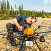 "Trevor Parcell with the Alaska Center for Unmanned Aircraft Systems Integration (ACUASI) sets up a piloting station on a gravel bar along the upper Chena River. The UAV pilot was taking part in a joint effort with the U.S. Fish and Wildlife Service to collect video of important king salmon spawning habitat.  <div class=""ss-paypal-button"">Filename: AAR-15-4593-097.jpg</div><div class=""ss-paypal-button-end""></div>"