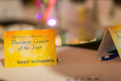 Custom cards decorate the tables in the Westmark Hotel Gold Room during UAF's School of Management Business Leader of the Year banquet.  Filename: AAR-14-4154-13.jpg