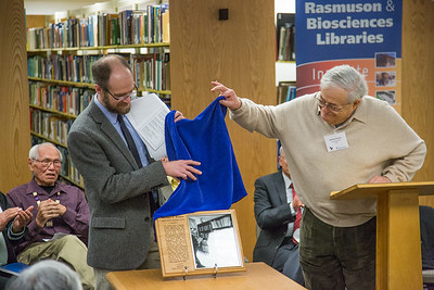 Director Gary Holton and Michael E. Krauss unveil a plaque dedicating the Alaska Native Languages Archive Feb. 22, 2013, at the Rasmuson Library.  Filename: AAR-13-3743-47.jpg