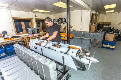 Technician Michael Cook works on one of the unmanned aerial vehicles in UAF's Alaska Center for Unmanned Aircraft Systems Integration (ACUASI) shop in south Fairbanks.  Filename: AAR-13-4026-127.jpg