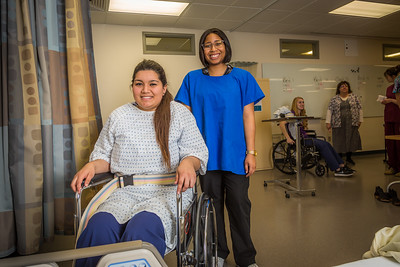 Chloe Gilbreath, right, and Laura Castro alternate practicing proper techniques for helping patients out of bed during an exercise in CTC's nursing assistant training at the program's facility on Barnette Street in downtown Fairbanks.  Filename: AAR-16-4873-260.jpg