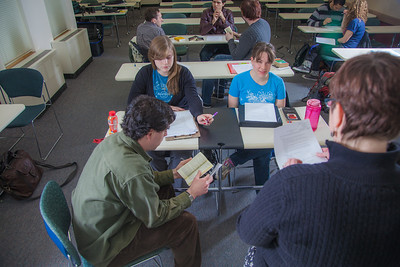 Professor Alexandra Fitts works with small groups of students in her Hispanic Theater class during a recent meeting in the Gruening Building.  Filename: AAR-12-3350-45.jpg