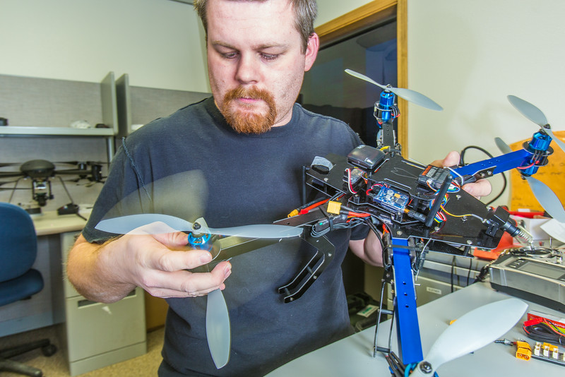 """Technician Michael Cook works on one of the unmanned aerial vehicles in UAF's Alaska Center for Unmanned Aircraft Systems Integration (ACUASI) shop in south Fairbanks.  <div class=""""ss-paypal-button"""">Filename: AAR-13-4026-92.jpg</div><div class=""""ss-paypal-button-end""""></div>"""
