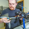 "Technician Michael Cook works on one of the unmanned aerial vehicles in UAF's Alaska Center for Unmanned Aircraft Systems Integration (ACUASI) shop in south Fairbanks.  <div class=""ss-paypal-button"">Filename: AAR-13-4026-92.jpg</div><div class=""ss-paypal-button-end""></div>"