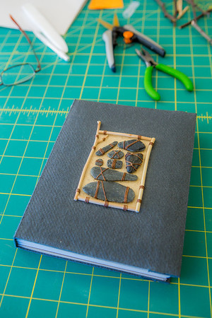 This is one of the completed projects in a custom book binding workshop offered by UAF Summer Sessions during Wintermester 2013.  Filename: AAR-13-3706-57.jpg