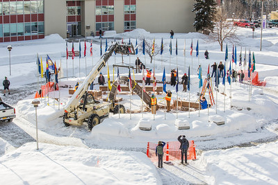 Engineering students and volunteers from GHEMM Company raise the 2013 ice arch in Cornerstone Plaza on the Fairbanks campus. Students this year built the structure out of a mixture of ice and sawdust, which is many times stronger than concrete.  Filename: AAR-13-3736-26.jpg