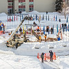 "Engineering students and volunteers from GHEMM Company raise the 2013 ice arch in Cornerstone Plaza on the Fairbanks campus. Students this year built the structure out of a mixture of ice and sawdust, which is many times stronger than concrete.  <div class=""ss-paypal-button"">Filename: AAR-13-3736-26.jpg</div><div class=""ss-paypal-button-end"" style=""""></div>"