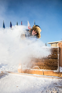 Engineering major Ryan Williams-Cudo, project leader of the traditional ice arch project, brushes the previous night's snowfall off the main structure. Cudo and other student engineers designed and built the 2013 ice arch using a combination of water and sawdust to end up with a substance many times stronger than concrete.  Filename: AAR-13-3733-39.jpg
