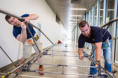 Elliott Anderson and Danny Smith of the UAF Steel Bridge team practice in the hallway of the Duckering Building before competing in the national competition.  Filename: AAR-16-4888-32.jpg