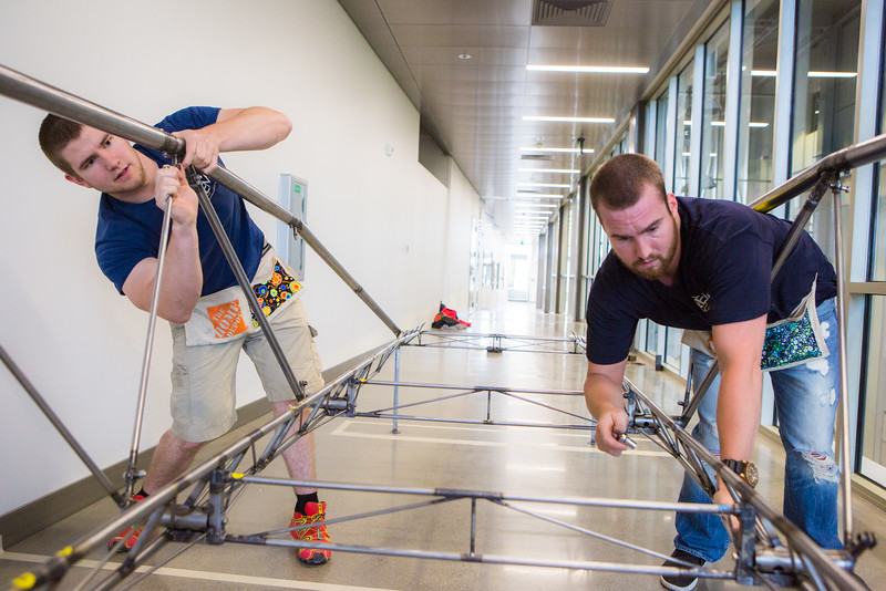 """Elliott Anderson and Danny Smith of the UAF Steel Bridge team practice in the hallway of the Duckering Building before competing in the national competition.  <div class=""""ss-paypal-button"""">Filename: AAR-16-4888-32.jpg</div><div class=""""ss-paypal-button-end""""></div>"""