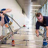 "Elliott Anderson and Danny Smith of the UAF Steel Bridge team practice in the hallway of the Duckering Building before competing in the national competition.  <div class=""ss-paypal-button"">Filename: AAR-16-4888-32.jpg</div><div class=""ss-paypal-button-end""></div>"
