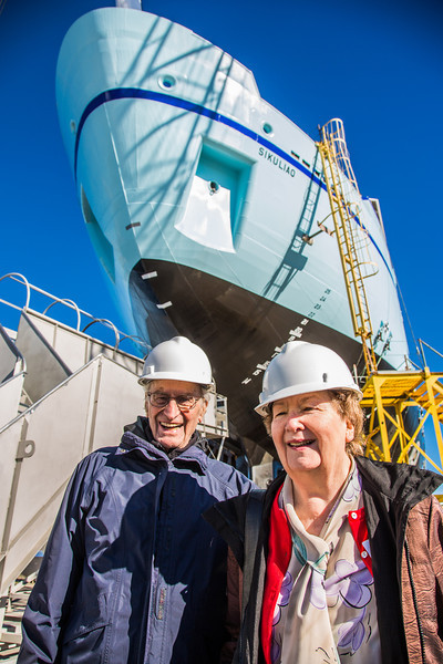 "Professors emeritus Bob Elsner and Vera Alexander stand under the R/V Sikuliaq during a tour of the shipyard the day before its launch Oct. 12 in Marinette, Wisc.  <div class=""ss-paypal-button"">Filename: AAR-12-3592-219.jpg</div><div class=""ss-paypal-button-end"" style=""""></div>"