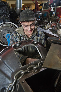 George Jensen disassembles a transmission in the diesel mechanics lab at the Hutchison Institute of Technology.  Filename: AAR-12-3312-040.jpg