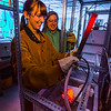 "Ph.D. candidate Amanda Lindoo pulls a rod containing volcanic remnants from a furnace in the Reichardt Building petrology lab under the watchful gaze of Research Assistant Professor Jessica Larsen.  <div class=""ss-paypal-button"">Filename: AAR-16-4828-063.jpg</div><div class=""ss-paypal-button-end""></div>"