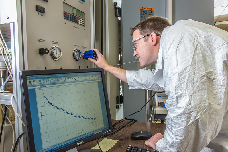 "Undergraduate John Cheshire conducts research in UAF's Petroleum Development Lab in the Duckering Building.  <div class=""ss-paypal-button"">Filename: AAR-13-3918-35.jpg</div><div class=""ss-paypal-button-end"" style=""""></div>"