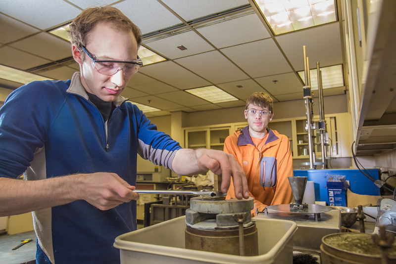 "Engineering majors Cody Klingman, front, and Logan Little measure dust samples in a Duckering building lab.  <div class=""ss-paypal-button"">Filename: AAR-13-3812-75.jpg</div><div class=""ss-paypal-button-end"" style=""""></div>"