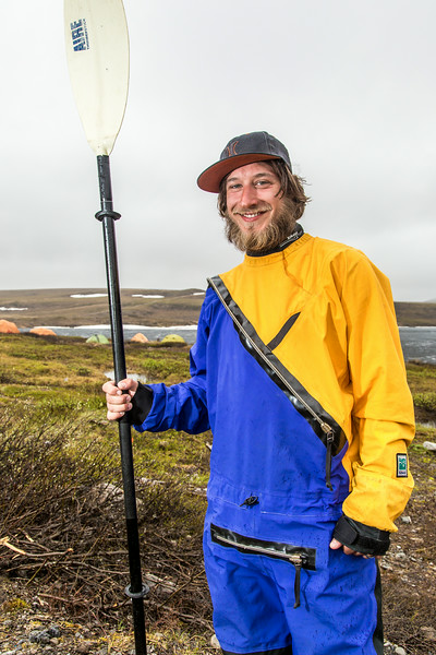 "Graduate student Levi Overbeck prepares to test a dry suit and raft paddling around Toolik Lake during his summer research season at the Toolik Field Station on Alaska's North Slope.  <div class=""ss-paypal-button"">Filename: AAR-14-4216-104.jpg</div><div class=""ss-paypal-button-end""></div>"