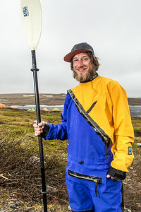 Graduate student Levi Overbeck prepares to test a dry suit and raft paddling around Toolik Lake during his summer research season at the Toolik Field Station on Alaska's North Slope.  Filename: AAR-14-4216-104.jpg