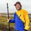"""Graduate student Levi Overbeck prepares to test a dry suit and raft paddling around Toolik Lake during his summer research season at the Toolik Field Station on Alaska's North Slope.  <div class=""""ss-paypal-button"""">Filename: AAR-14-4216-104.jpg</div><div class=""""ss-paypal-button-end""""></div>"""