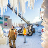 "Volunteers from GHEMM, Inc. use a crane to lift the buttresses for this year's student-built ice arch into position in Cornerstone Plaza on campus. The annual ice arch is designed and built by a team of engineering students, a UAF tradition going back more than 60 years.  <div class=""ss-paypal-button"">Filename: AAR-14-4078-15.jpg</div><div class=""ss-paypal-button-end""></div>"