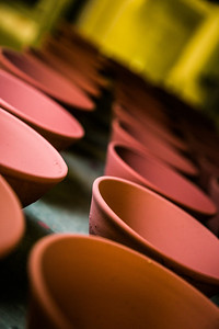 Ceramic bowls fresh out of the kiln cool on a shelf in UAF's ceramics studio. Art major Ian Wilkinson has thrown more than 1,000 of the same-sized bowls as part of his senior thesis.  Filename: AAR-13-3752-13.jpg