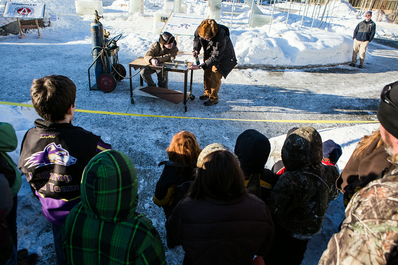 """Children and their parents are given a demonstration of rocket fuel during Eweek open house in the Duckering Building on campus.  <div class=""""ss-paypal-button"""">Filename: AAR-14-4081-109.jpg</div><div class=""""ss-paypal-button-end""""></div>"""