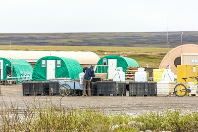 A staff member at the Toolik Field Station empties trash to be hauled away from the remote research facility, located along the Dalton Highway about 370 miles north of Fairbanks on Alaska's North Slope.  Filename: AAR-14-4216-314.jpg