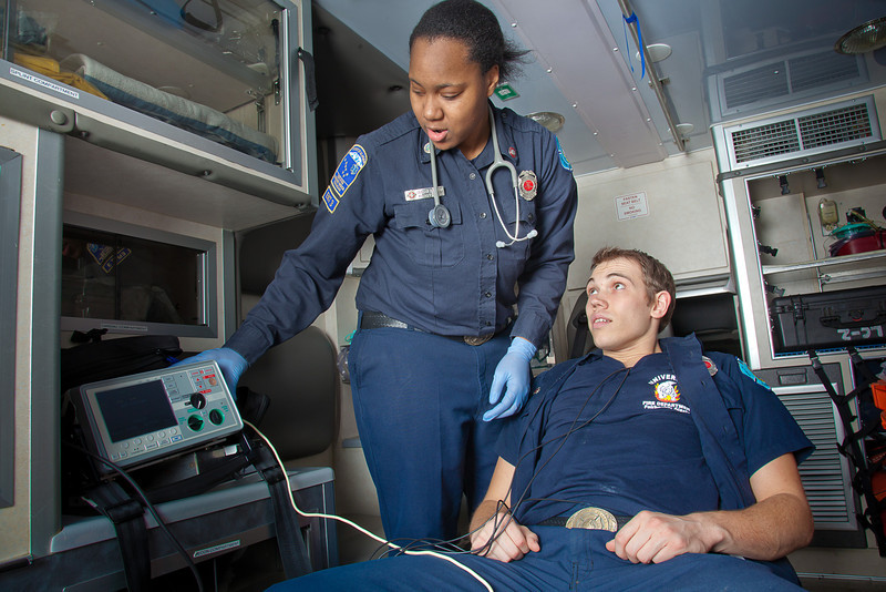 """UAF student firefighters/EMTs Lillian Hampton and Cory Kelly practice on each other during a training exercise in the back of an ambulance housed in the Whitaker Building on the Fairbanks campus.  <div class=""""ss-paypal-button"""">Filename: AAR-11-3223-64.jpg</div><div class=""""ss-paypal-button-end"""" style=""""""""></div>"""