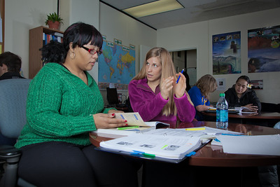 Lauren Divine, right, a tutor with UAF's Student Support Services, works with Sante Lee-Sonkoh during a session in the SSS study lounge in the Gruening Building.  Filename: AAR-12-3285-046.jpg
