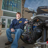 "Mechanical enineering major Ben Neubauer poses with the UAF team's snowmobile in front of the Duckering Building after its return from competing in the Society of Automotive Engineers' Clean Snowmobile Challenge in Houghton, Mich.  <div class=""ss-paypal-button"">Filename: AAR-12-3345-100.jpg</div><div class=""ss-paypal-button-end"" style=""""></div>"