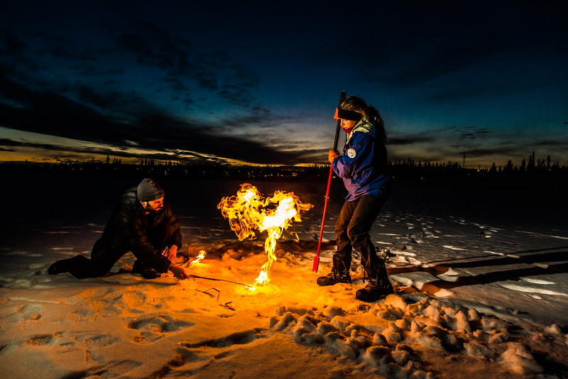 "Research Associate Professor Katey Walter Anthony and a research assistant set fire to escaping methane gas trapped beneath the ice on a pond near the UAF campus. The naturally occurring phenomenon is made worse by thawing permafrost and increased plant decay caused by global warming.  <div class=""ss-paypal-button"">Filename: AAR-16-4815-68.jpg</div><div class=""ss-paypal-button-end""></div>"