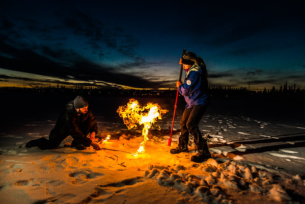 """Research Associate Professor Katey Walter Anthony and a research assistant set fire to escaping methane gas trapped beneath the ice on a pond near the UAF campus. The naturally occurring phenomenon is made worse by thawing permafrost and increased plant decay caused by global warming.  <div class=""""ss-paypal-button"""">Filename: AAR-16-4815-68.jpg</div><div class=""""ss-paypal-button-end""""></div>"""