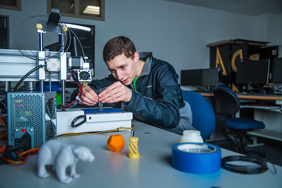 Isaiah Ramirez keeps watch as his design project goes from concept to reality in UAF's Community and Technical College's 3-D print lab in downtown Fairbanks.  Filename: AAR-16-4857-082.jpg