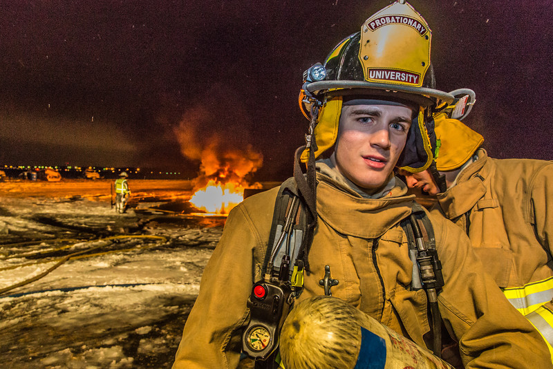 """Probationary firefighter Kristjahn Boyd takes part in a live training drill at the Fairbanks International Airport.  <div class=""""ss-paypal-button"""">Filename: AAR-13-3995-218.jpg</div><div class=""""ss-paypal-button-end"""" style=""""""""></div>"""