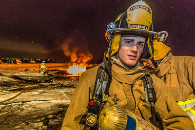 Probationary firefighter Kristjahn Boyd takes part in a live training drill at the Fairbanks International Airport.  Filename: AAR-13-3995-218.jpg