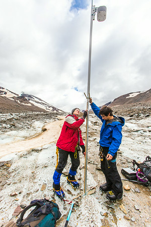 Professor Regine Hock, a glaciologist with UAF's Geophysical Institute, and Tristan Weiss, a research technician with the Institute of Northern Engineering, measure the depth of the ice near the toe of the Jarvis Glacier in the eastern Alaska Range.  Filename: AAR-14-4256-431.jpg